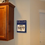 Navy-Blue-Race-Bib-Holder-On-Wall