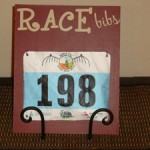 Red Race Bib Holder On Table